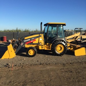 tracy-grading-paving-tractor-loader-deere-210l
